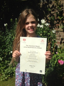 Gracie & her Grade 1 Distinction Certificate